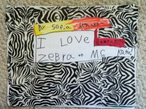 This work of art is a book with facts about zebras,beautiful illustrations, and a cover made with pieced together zebra duct tape.